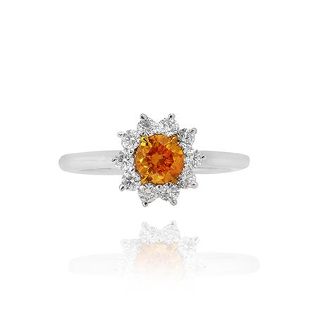 Ring with natural colored diamond of round cutting shape