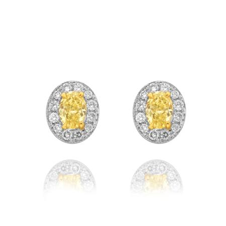 Earrings with yellow diamonds of oval shape