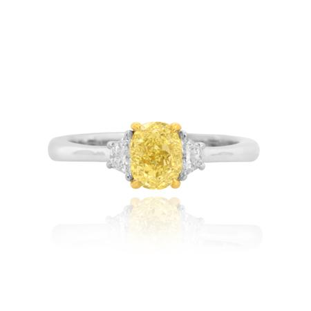 Ring with yellow diamond of oval shape cutting