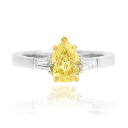 Ring with yellow diamond of drop shape cutting