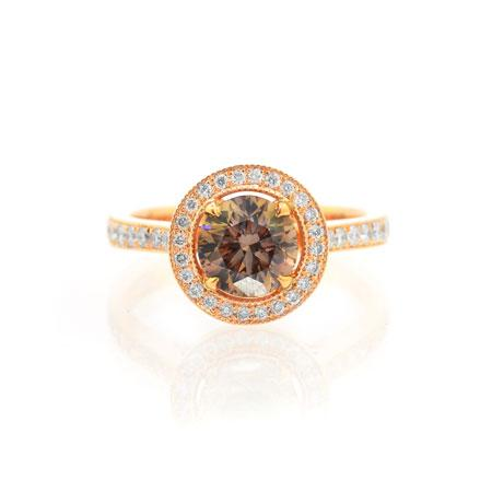 Golden ring with natural brown diamond