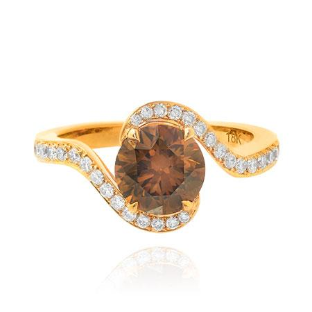 Ring with round diamond of brown color