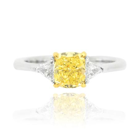 White gold ring with yellow diamond of cushion cutting