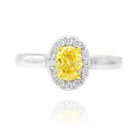 Ring with yellow diamond of oval shape