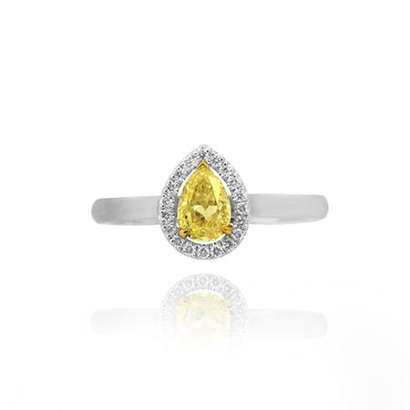 Ring with yellow diamond of drop shape